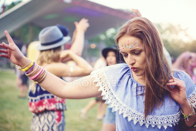 Portrait of Young woman dancing at festival — Stock Photo