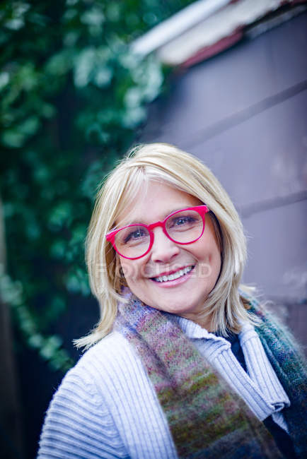 Portrait of mature woman in red spectacles — Stock Photo