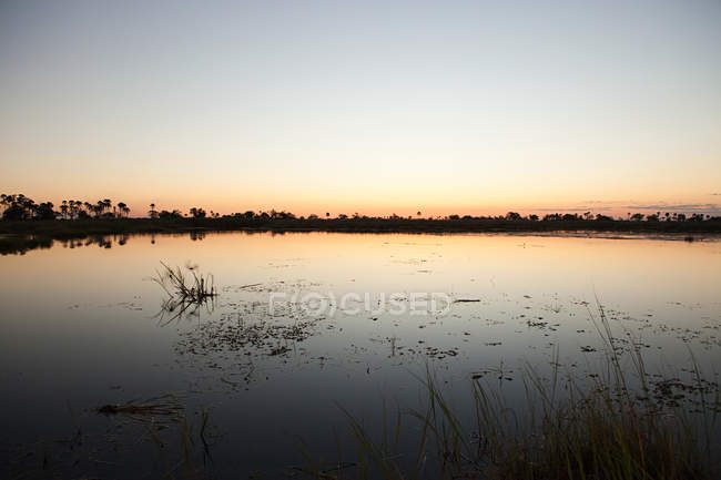 Sunset on water in Okavango Delta, Botswana, Africa — Stock Photo