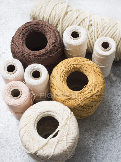 Stack of various colorful spools, close-up view — Stock Photo