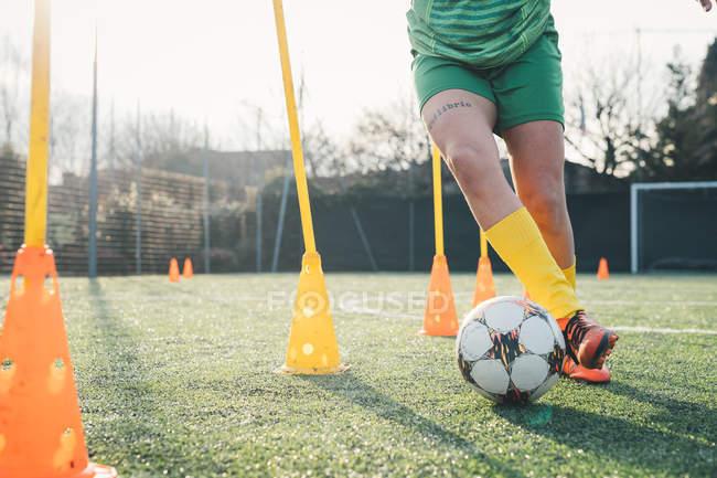Football player dribbling ball — Stock Photo