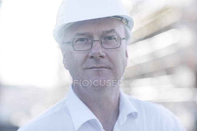 Portrait of adult Construction worker with eyeglasses and helmet — Stock Photo