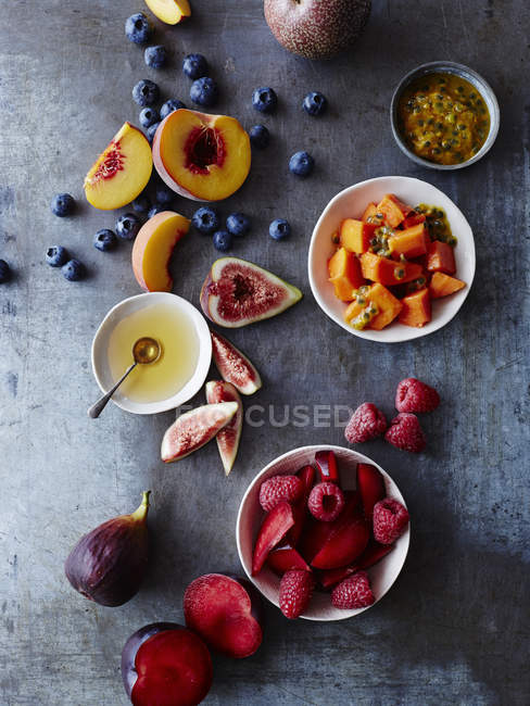 Still life of food bowls and fresh fruit, overhead view — Stock Photo