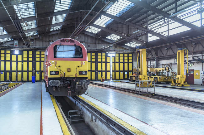 Locomotive being refurbished in train engineering factory — Stock Photo