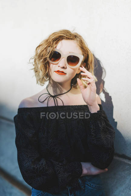Portrait of red haired woman wearing sunglasses — Stock Photo
