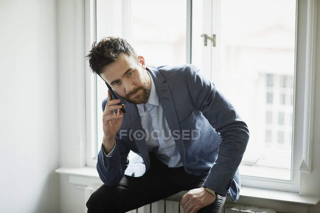 Businessman making telephone call on smartphone — Stock Photo