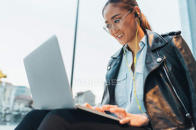 Businesswoman using laptop on video call outdoors — Stock Photo