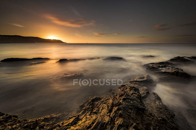 Scenic view of Chapel Rock at sunset, Perranporth, Cornwall, England — Stock Photo
