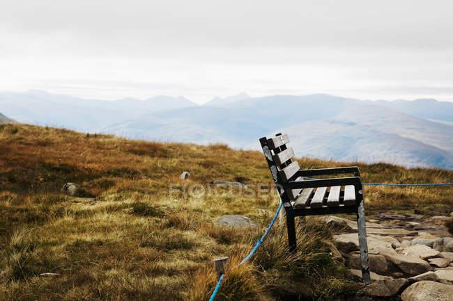 Beautiful landscape with bench on mountain, Glen Nevis, Scotland, UK — Stock Photo