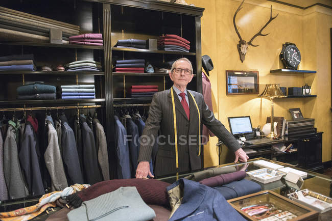 Portrait of senior tailor in tailors shop — Stock Photo
