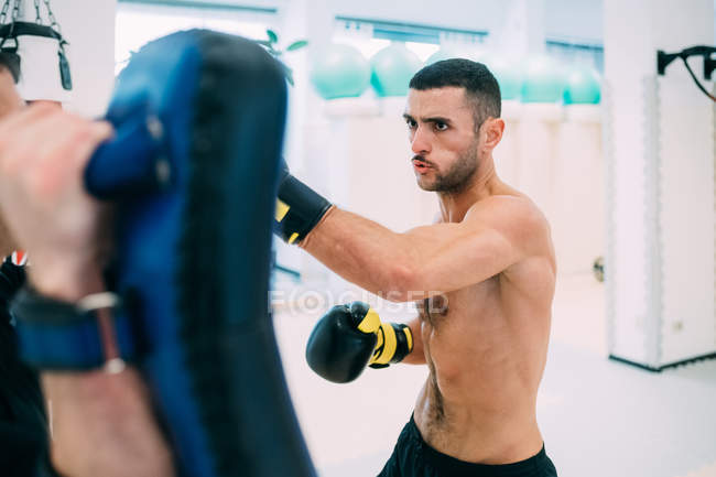 Man with personal trainer sparring in gym — Stock Photo