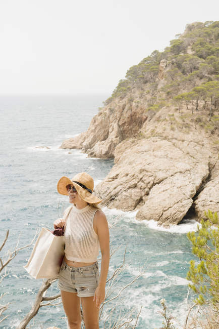 Woman in sun hat looking at view, Tossa de mar, Catalonia, Spain — Stock Photo