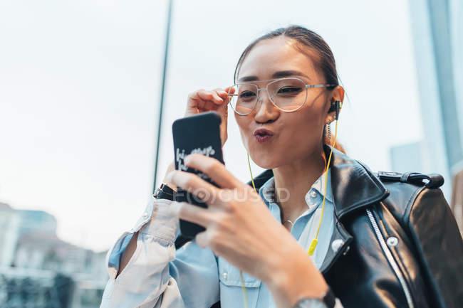 Businesswoman using smartphone on video call — Stock Photo