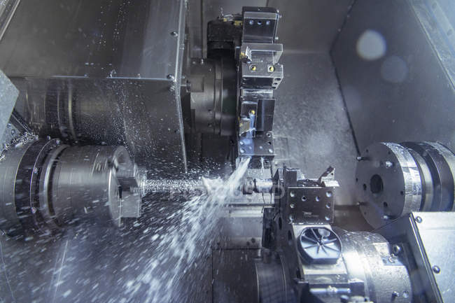 Close up of lathe cutting metal in engineering factory — Stock Photo
