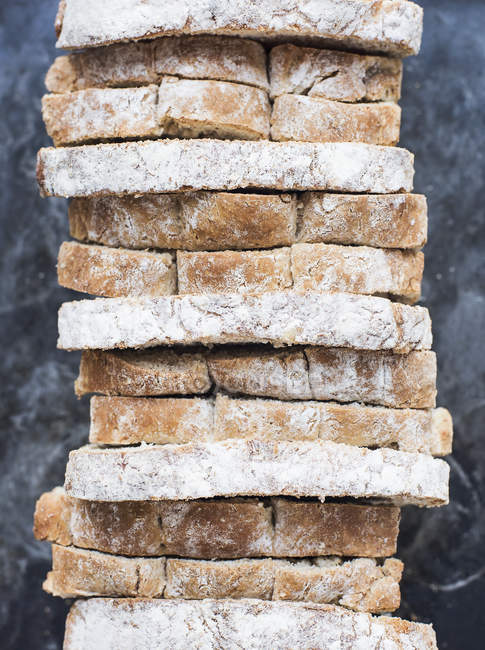 Stack of whole grain oat bread slices — Stock Photo