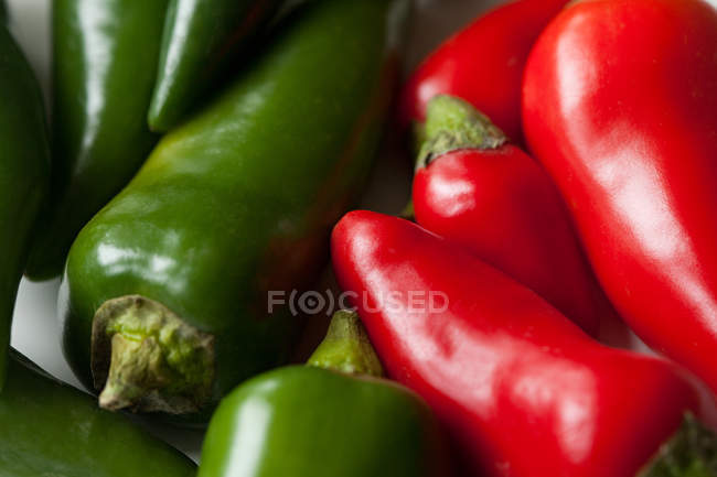 Green and red chilli peppers, full frame — Stock Photo