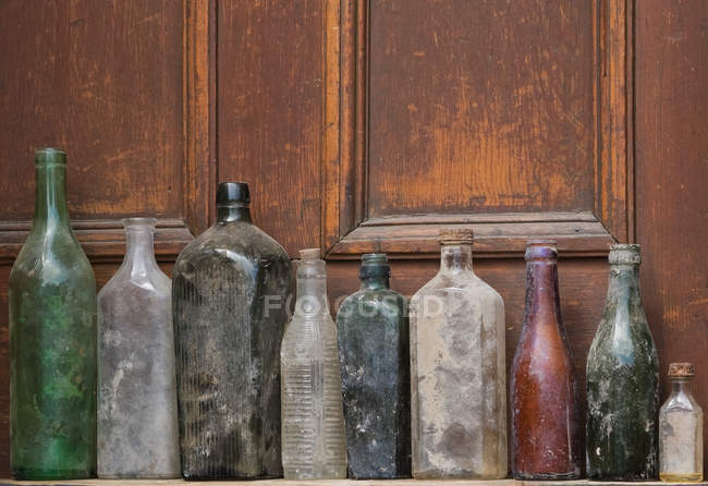 View of old glass bottles in row — Stock Photo