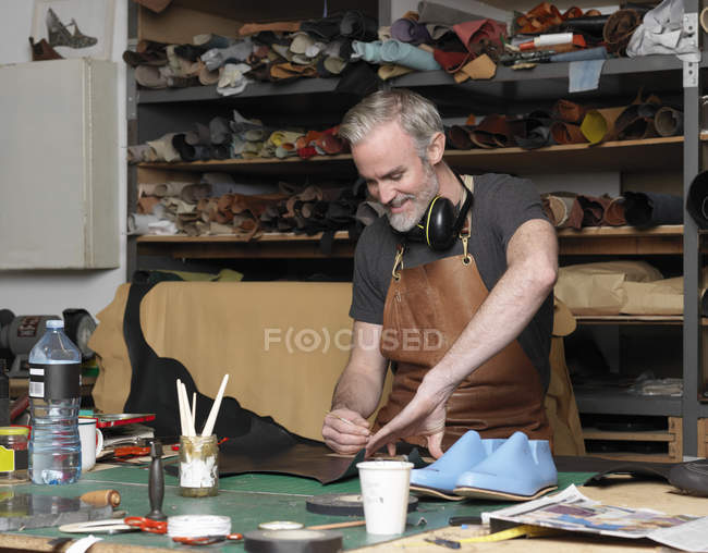 Man making shoes, selective focus — Stock Photo