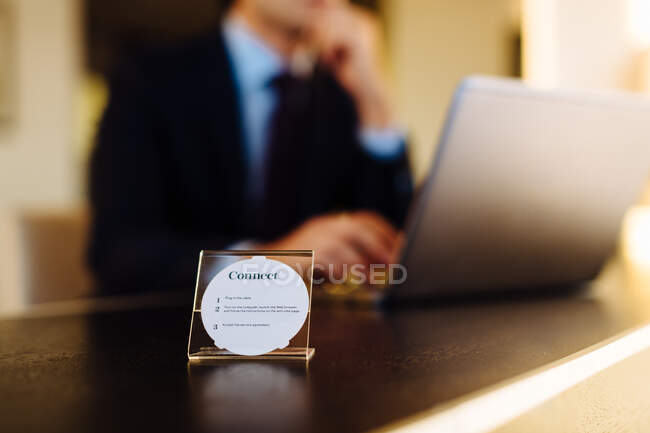 Businessman working in business centre in hotel — Stock Photo