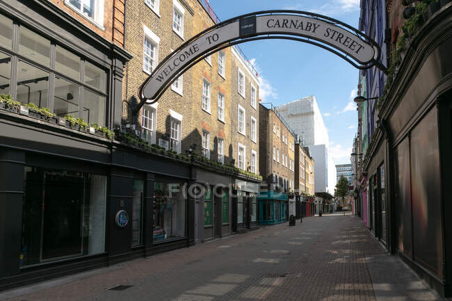 View along an empty Carnaby Street in London during the Corona virus crisis. — Stock Photo