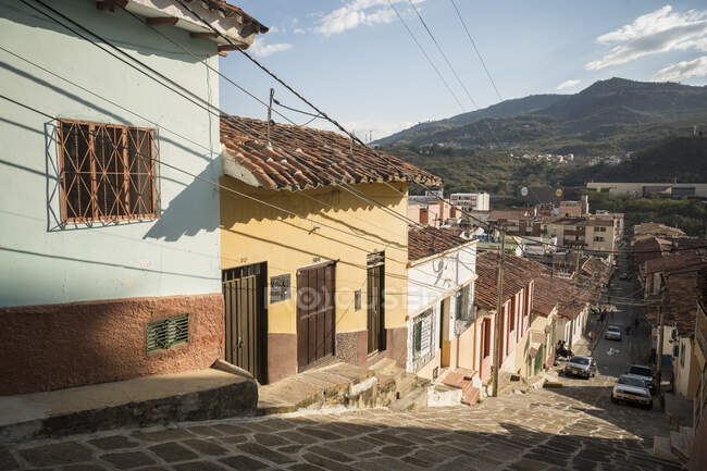 Street scene, a town with cobbled streets and low houses in a valley in the mountains. — Stock Photo