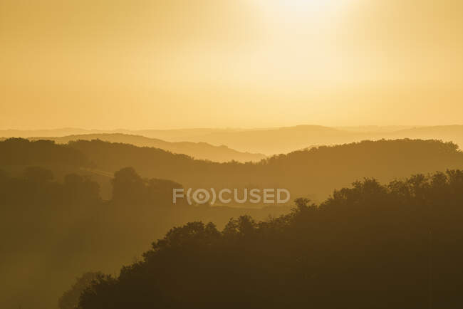 Misty landscape at sunrise, Prades, Midi Pyrenees, France — Fotografia de Stock