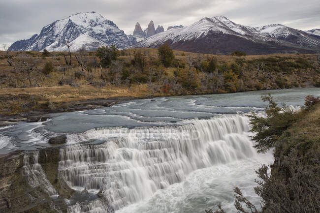 View over Paine Cascades and distant mountains, Torres Del Paine National Park, Chile — Stock Photo
