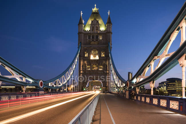 View of traffic light trails on Tower Bridge at night, London, Uk — Stock Photo