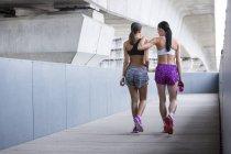 Women in sports wear walking away — Stock Photo