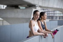 Young women in sports clothing resting — Stock Photo