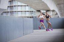 Young women racing outdoors — Stock Photo