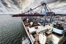 Shipping containers on rig in industrial harbor. — Stock Photo