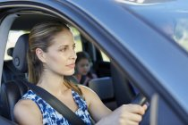 Woman driving car and looking away. — Stock Photo