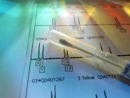 DNA swab on genetic test results. — Stock Photo