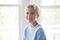 Portrait of preteen boy smiling and looking in camera. — Stock Photo