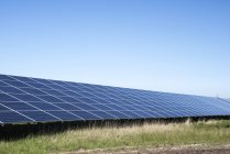 Row of solar panels at solar farm in North Wales, UK. — Stock Photo