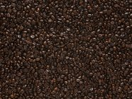 Roasted brown coffee beans, full frame. — Stock Photo