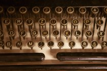 Close-up of round keys on antique keyboard of vintage type machine. — Stock Photo