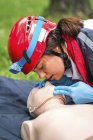 Female paramedic CPR training with dummy outdoors. — Stock Photo