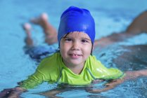 Little boy having swim class with female instructor in swimming pool. — Stock Photo
