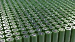 3d иллюстрация сотен зеленых батареек все в ряд . — стоковое фото