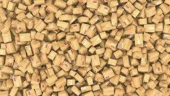 Illustration 3D de centaines de colis en carton empilés en tas . — Photo de stock
