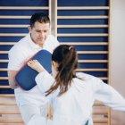 Taekwondo instructor working with child. — Stock Photo