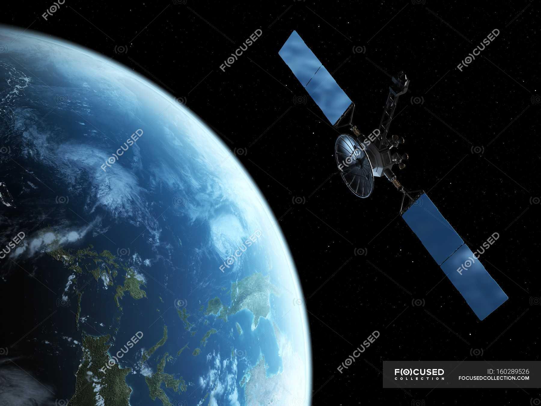 satellite orbiting earth black background solar panel stock