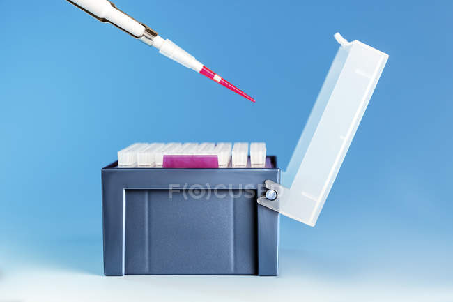 Pipette over medical samples in box. — Stock Photo