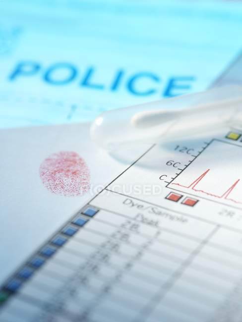Police evidence including finger print, DNA swab and results. — Stock Photo