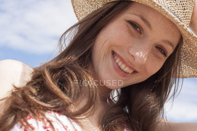 Happy young adult woman in sunhat. — Stock Photo