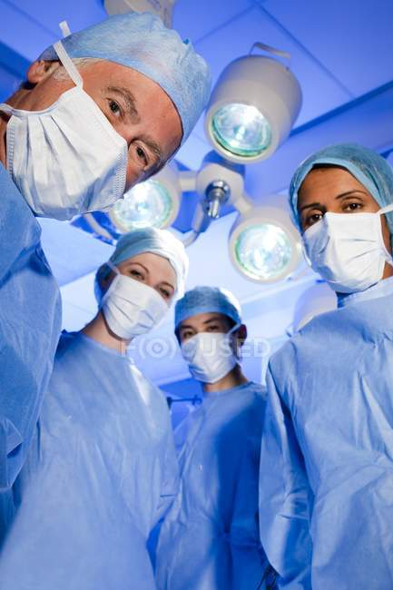 Portrait of surgical team in face masks. — Stock Photo