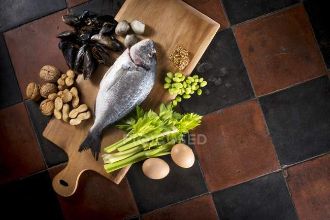 Allergens foods on wooden board — Stock Photo