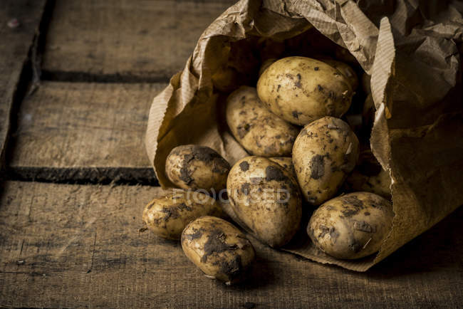 Potatoes in paper bag — Stock Photo